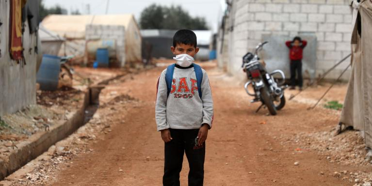 A Syrian boy poses for a picture during an awareness workshop on coronavirus (COVID-19) at a camp for displaced people in Atme town in Syria's northwestern Idlib province, near the border with Turkey. Photo: AAREF WATAD / AFP / NTB Scanpix
