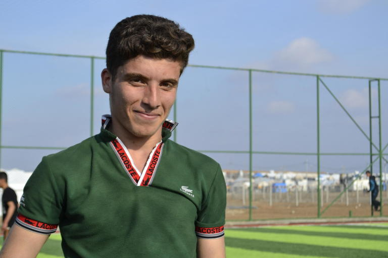 Eighteen-year-old Mazhr had to flee his home in Mosul when the city was attacked by the IS group and has been living in Hamam Al-Alil camp since it opened in May 2017.  Mazhr has a great passion for football. He was a member of Mosul football club, and dreams of joining the Iraqi national team someday. Photo: Helen Baker/NRC