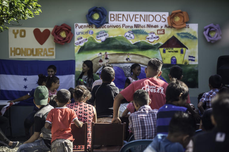 Holidays are soon here, and these kids are listening to one of the teachers who is holding a speech for the pupils. The school is situated in one of the most dangerous neighbourhoods in the world, outside the city San Pedro Sula in Honduras.  Photo: Ana KArina Delgado Diaz/NRC