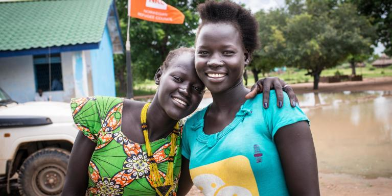 "Elizabeth Kuach, 16, and Mary Aduol, 18, stand outside NRC's youth center in Gordhim, South Sudan. Elizabeth and Mary are studying full-time in the YEP centre, learning basic numeracy and literacy as well as vocational skills such as baking, carpentry, and agriculture. ""We like learning in the center because we learn something new every day,"" said Mary Aduol. Photo by David Belluz/NRC 2017"
