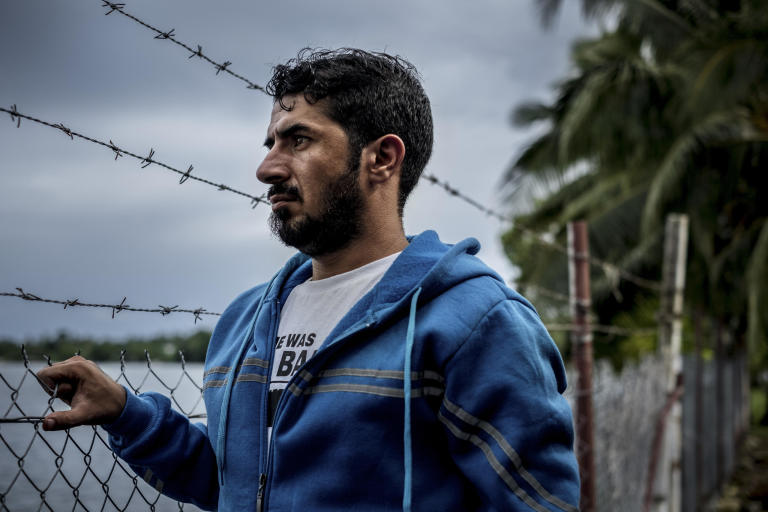"Behnam Satah, a Kurdish refugee who holds a masterâä? s in English education, on Manus Island, Papua New Guinea, Nov. 16, 2016. The refugees banished by Australia to quasi-prisons in the South Pacific are experiencing some of the most brutal and sinister exercises conducted in near secrecy beneath the green canopy of the tropics. âä? Sometimes I cut myself so that I can see my blood and remember, âä? Oh, yes! I am alive,'"" Satah said. (Ashley Gilbertson/The New York Times)"