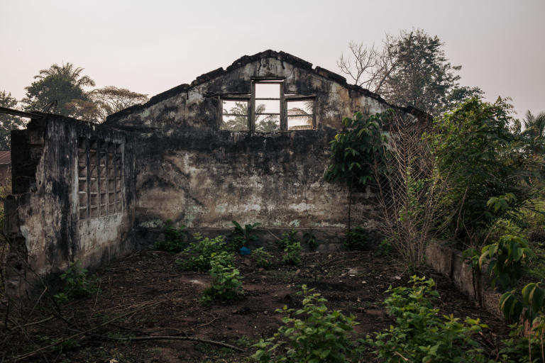 "View of the ruins of an administrative building in the village of Mbulungu. In early 2017, armed militias took control of the area. They systematically destroyed official buildings and attacked government officials.   Over 1 million people have returned to their homes in Kasai-Central after a year of violent conflict within the province and across the Greater Kasai Region.  Unfortunately, people who have returned have found their homes and fields pillaged and burned to the ground.  These farming communities have no shelter, no food to eat and no means of sustaining any viable livelihood.  Earlier this year, NRC visited Mbulungu and Bakuakashila, two villages ravaged by the regional conflict in 2017.  NRC used its ""community-based approach"" by consulting with these communities to better understand their primary needs, to properly target the most vulnerable people and facilitate their ability to choose the assistance they require.  This intervention, however, is only a drop in the ocean of the vast needs of this community.  NRC is currently the only humanitarian actor in the zone and funding is not enough to address other acute needs such as food assistance, household items and education.  The Humanitarian Response Plan is currently only 25 per cent funded eight months into the year.  Humanitarian capacity is critically low.  If donors do not act now for the people of Mbulungu and for the rest of DR Congo, it will be too late.  August 29, 2018 - Kasai-Central Province, DR Congo  Photo: NRC/Aléxis Huguet"