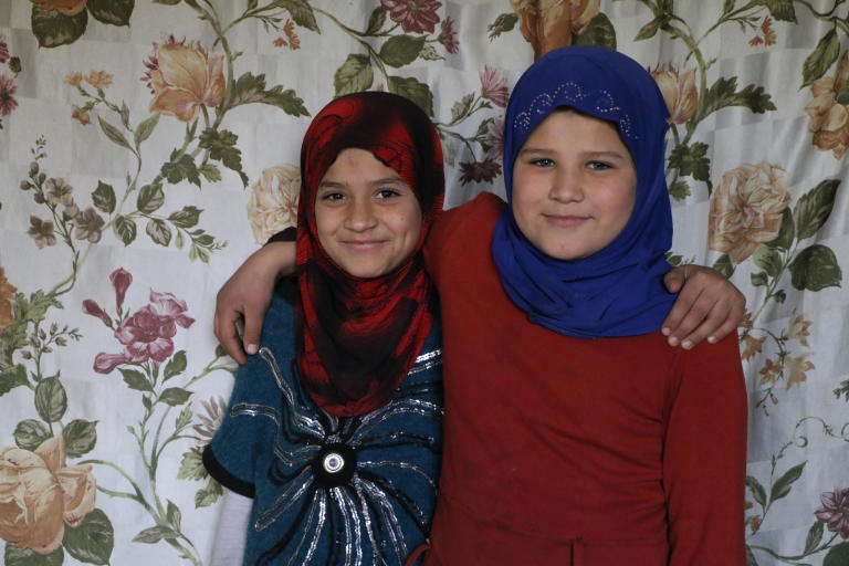 The girls, Aya* (9), and Sarah* (10), who want to become teachers in the future, created a small corner in the sitting room where they study their lessons and write their Home works.  Photo: Nadine Malli/NRC