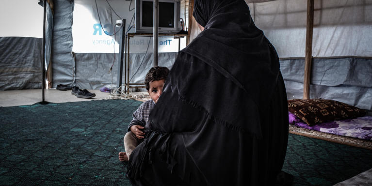 "Hana, mother of seven children, fled Hawija in 2017 as the Iraqi government retook the city, one of the last remaining IS strongholds, to a displacement camp in Kirkuk governorate. Intelligence officials confiscated her civil documentation after she arrived in the camp. ""My husband joined IS while the group was in control, but he died in an airstrike with my eldest son in 2017,"" she says.  Now she and her children are alone and unable to leave the camp, barred from attending school and denied access to healthcare and social welfare.  ""My husband took the wrong path. He took my oldest son and left us to fight with Islamic State. They are both dead now, and I am alone in this camp with my young children. Three of them don't even have identity documents (ID). My husband destroyed our lives, me and my children suffer,"" the widow says. 	 Her three children born under IS rule do not possess birth certificates and, as a result, cannot obtain IDs. She says during the winter, her children got sick from the cold but was unable to take them to a hospital outside the camp.   She tried to seek assistance from a lawyer working with a humanitarian organization to start the procedure to formally divorce her husband and try get her ID back and obtain documents for her children, but they said they were unable to assist because of accusations of IS affiliation. She says the humanitarian assistance she receives is limited because priority is given to those can provide identification.   * Name was changed for protection concerns. Photo : Tom Peyre-Costa/NRC"