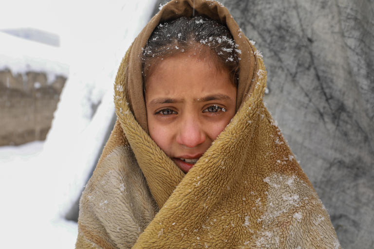 """It was very cold inside and I thought if I go outside and walk I might feel warmer,"" says Roqia, 11, standing outside her makeshift home in a snowy day in KABUL.   Rogia doesn't have enough clothes and proper slippers to keep her warm in a cold. Her family do not have sufficient firewood to keep the oven burning all the time and they only burn it once in a day and if the weather is freezing cold, they might burn it twice in a day. They burn plastics, cartons, packets and other waste materials they have collected during the summer season.  ""The house we have is out of plastic bags, blankets and mud. As soon as the oven dies the home gets cold,"" she says. ""It's very cold during the night and we wakeup many times due to cold. Sometimes, I feel pain and burn in my feet, legs and back due to the cold.""   Kabul gets very cold during the winter and last night only, the temperature dropped to -16 Celsius. Photo: Enayatullah Azad/ NRC"