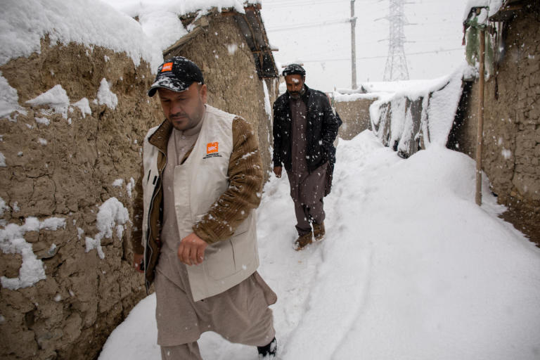 NRC shelter and WASH team doing a walkabout in Hiwadwal IDP Settlement in Kabul on a snowfall day. It's first winter snow in Kabul and thousands of IDP families are living in substandard makeshift making them disposed to freezing temperature. Photo: Enayatullah Azad / NRC